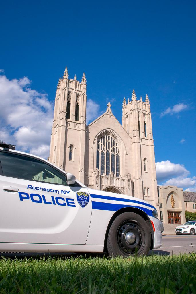 A Rochester Police Department vehicle is parked outside of Sacred Heart Cathedral during the Mass.