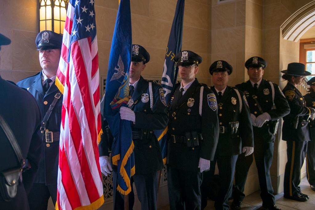 Officers prepare to process into the cathedral.