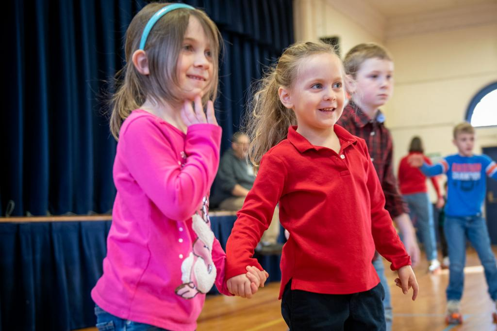 St. Agnes students hold hands while skating. (Courier photo by Jeff Witherow)