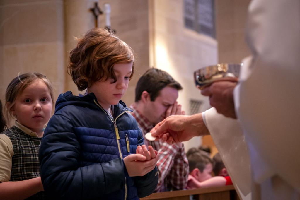 Charlie Robak, a student at St. Mary School in Canandaigua, receives Communion.