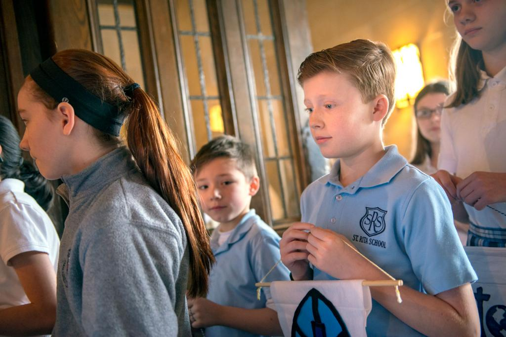 Fifth-grader Will McCarthy of St. Rita School in Webster processes into Sacred Heart Cathedral during a Jan. 31 Mass celebrating Catholic Schools Week.