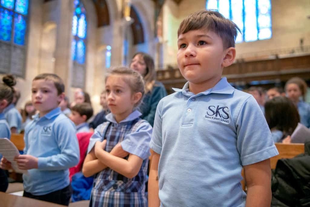 Antonio Rodriguez, a first-grader at St. Kateri School in Irondequoit, stands at the start of the Catholic Schools Week Mass. (Courier photo by Jeff Witherow)