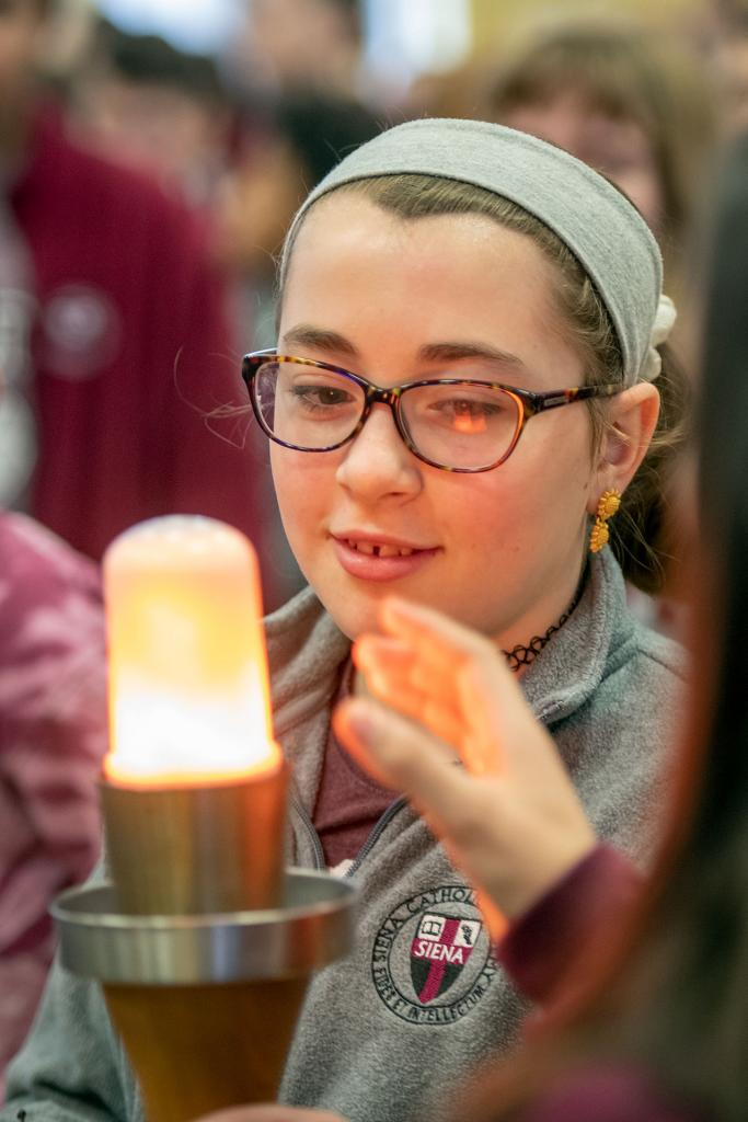 Sixth-grader Liberty Springer passes the torch for the Empire State Winter Games. (Courier photo by Jeff Witherow)