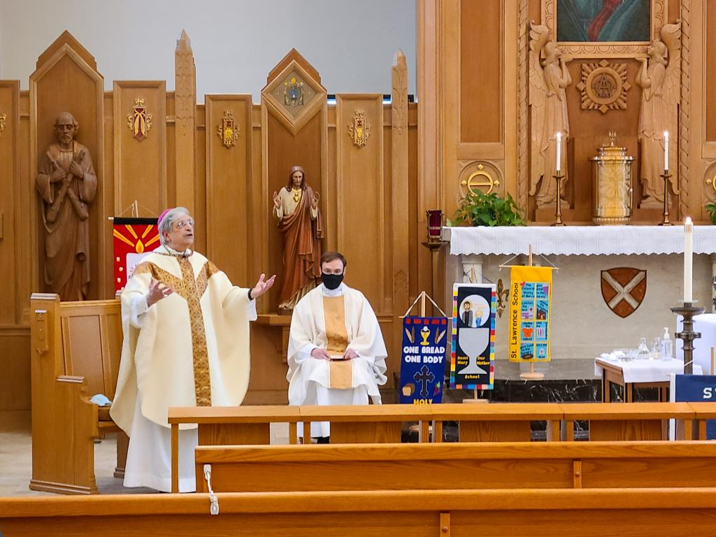 Bishop Salvatore R. Matano gives the homily during the Catholic Schools Week Mass at the Pastoral Center chapel in Gates.