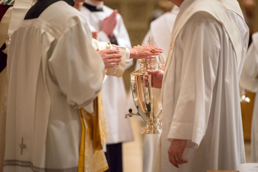 The Oil of the Catechumens is brought forth to be consecrated.
