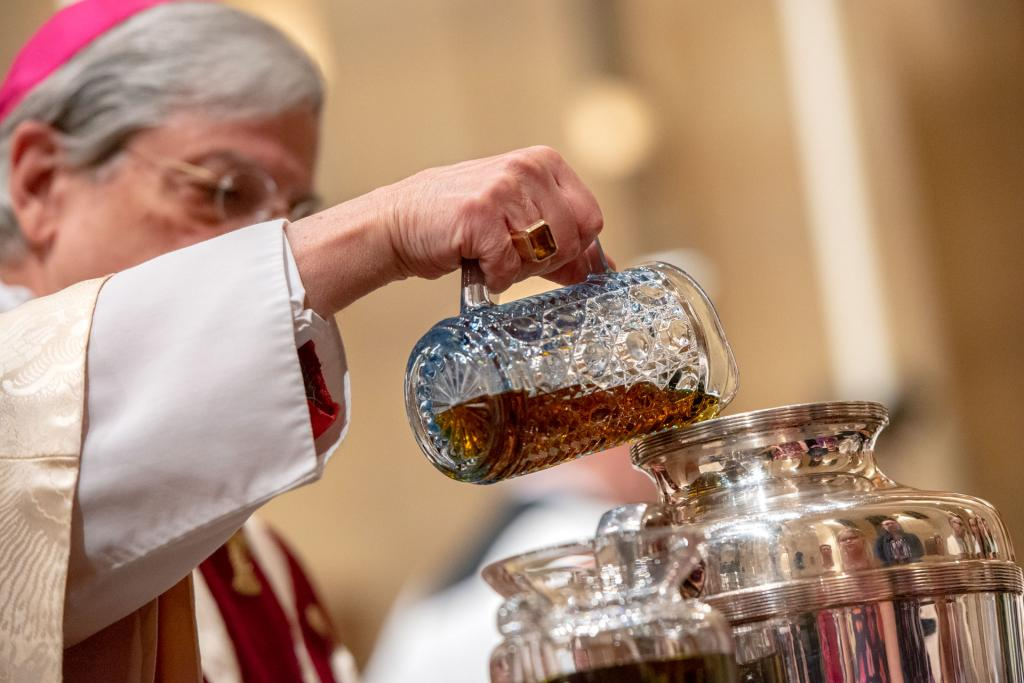 Bishop Salvatore R. Matano pours the balsam into oil for the Sacred Chrism.