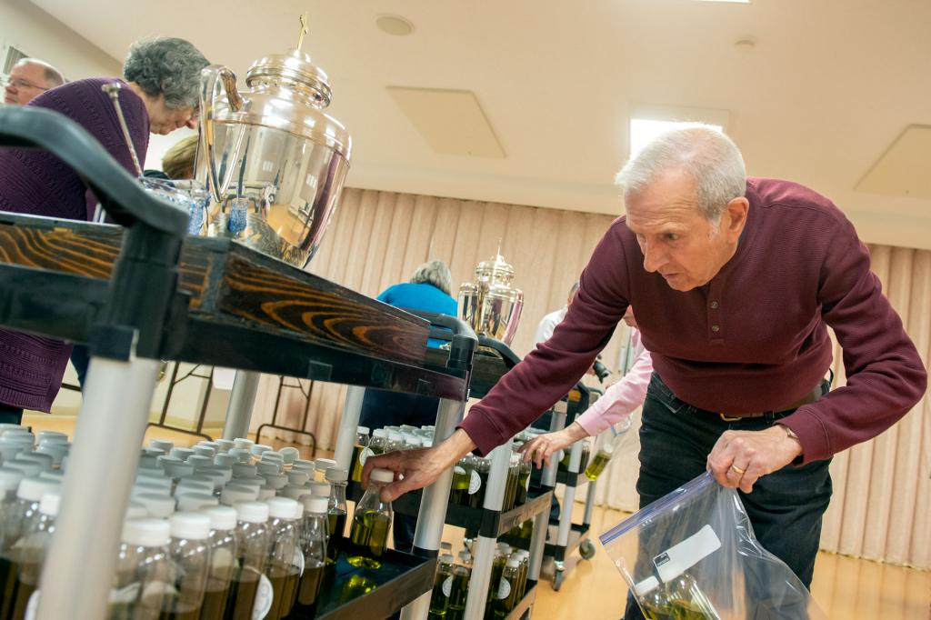 Dan Gentile prepares the sacred oils for distribution to parishes.