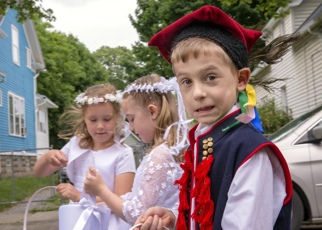 Anthony Makula,dressed in traditional Polish attire,participates in a eucharistic procession around St. Stanislaus Kostka Church in Rochester.