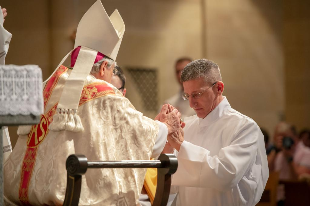 Roger DeBell promises respect and obedience to Bishop Matano and his successors.
