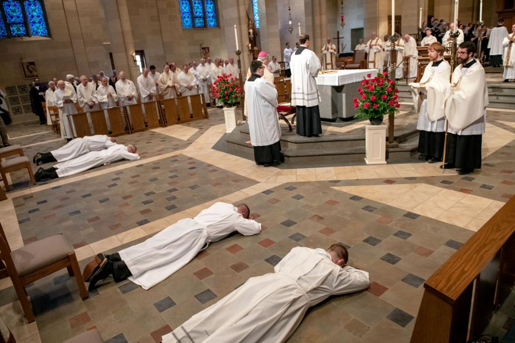 The four candidates prostrate themselves during the Litany of the Saints.