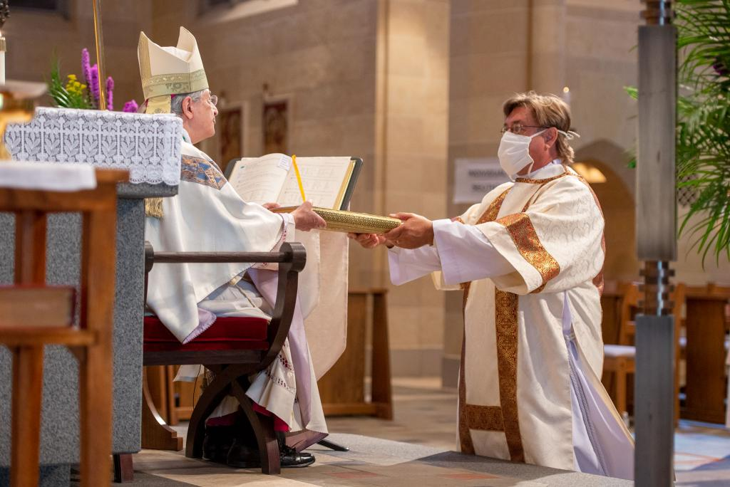 Deacon Johan Engström is presented with the Book of the Gospels.