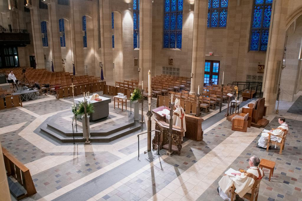Bishop Matano delivers his homily during a livestream of the Easter Vigil April 11.
