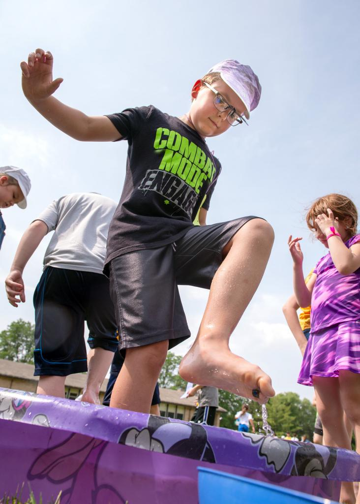 Imi Knausz plays a marble game during the Fun Fest at St. Joseph School.