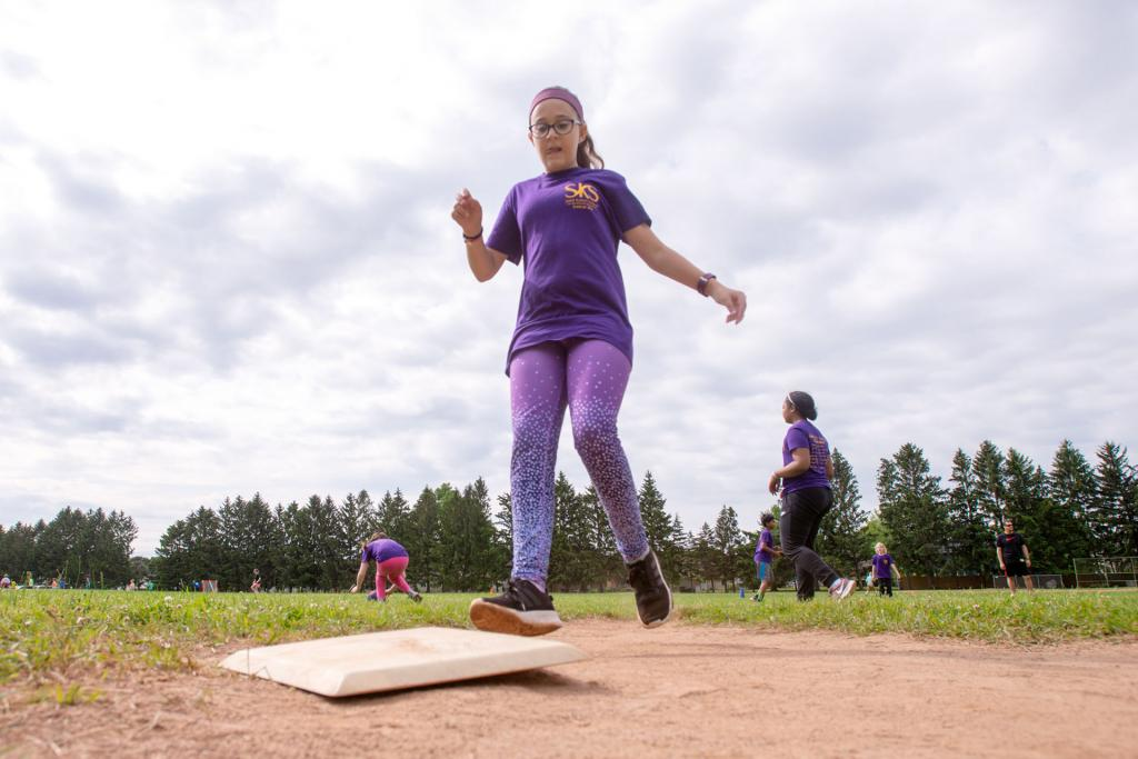 Molly Carroll lands on third base during a field day kickball game at St. Kateri School in Irondequoit June 18. (Courier photo by Jeff Witherow)