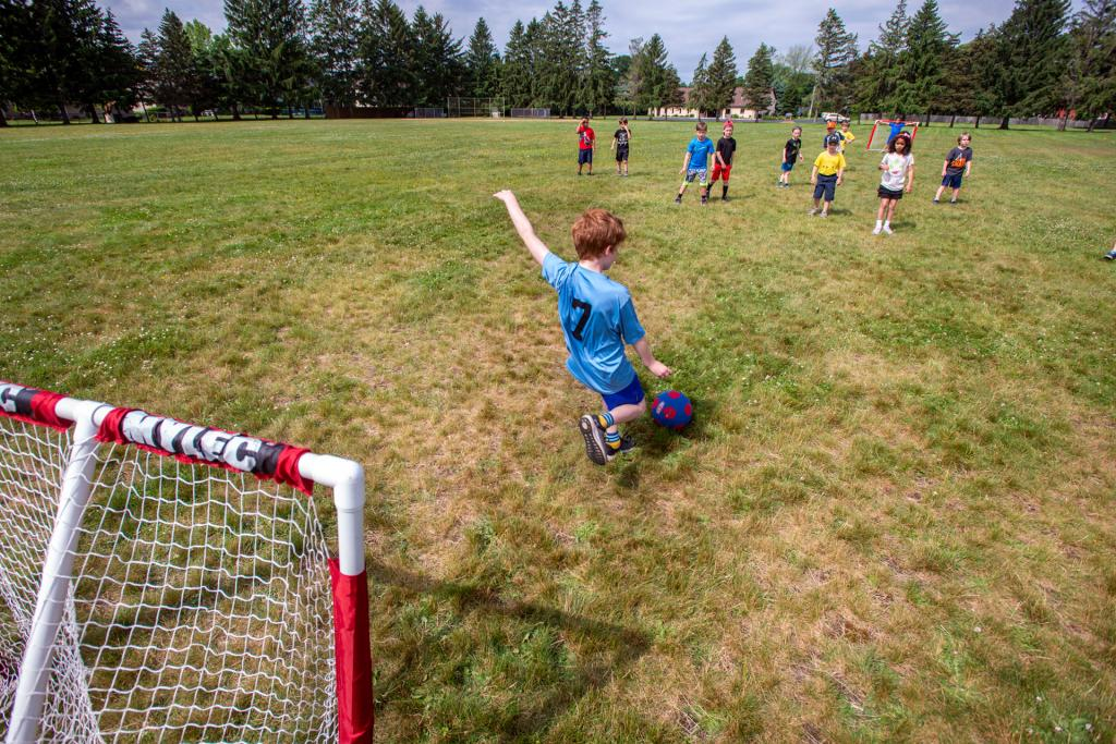 Goalie Riordan Whelehan kicks the ball during a field day soccer game at St. Kateri School in Irondequoit June 18. (Courier photo by Jeff Witherow)