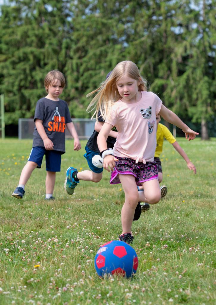 Rosie Tortora chases the ball during the field day activities at St. Kateri School in Irondequoit June 18. (Courier photo by Jeff Witherow)