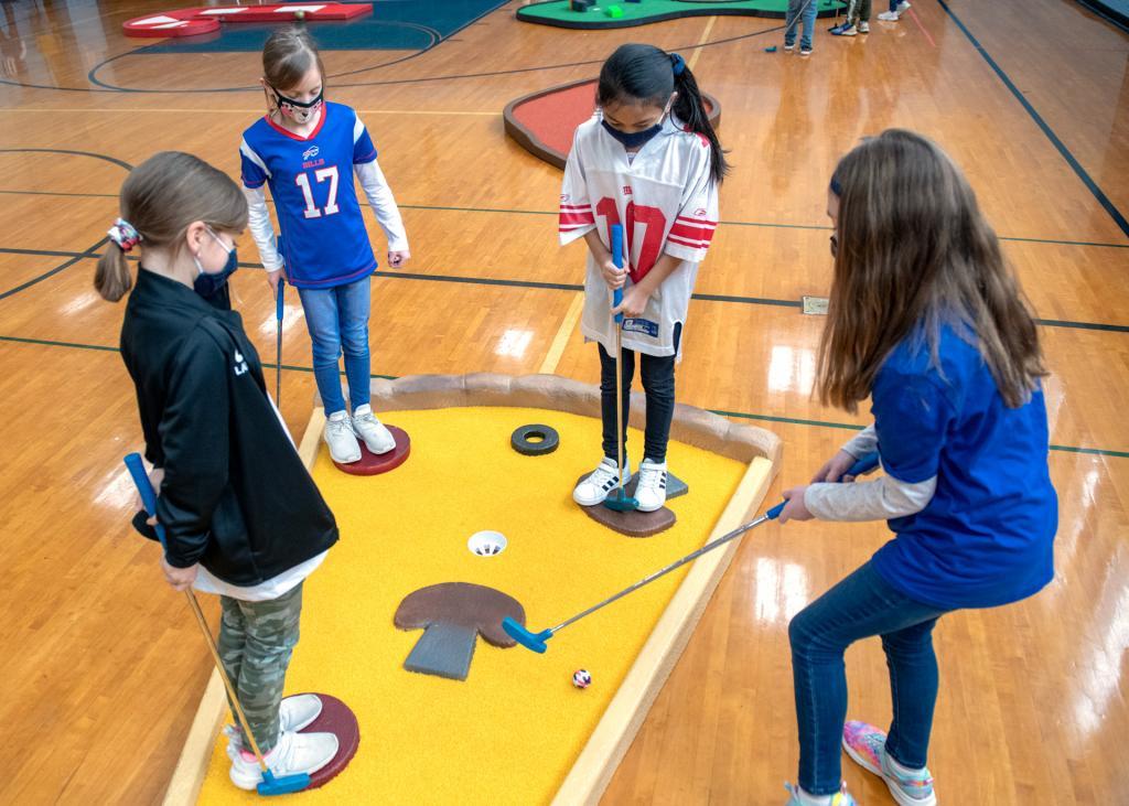 Olivia Laudisi (from left), Hannah Wegman, Lily Mallare and Brianna Fella play on a hole shaped like a slice of pizza.