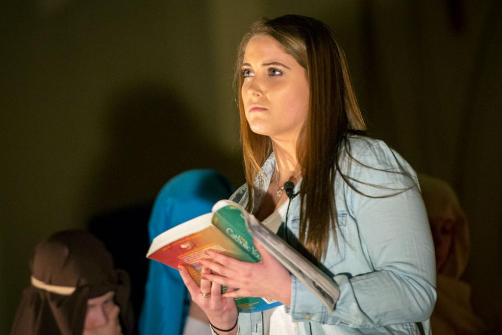 Lexie Johnson is the modern reader during the performance.