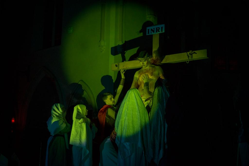 Jesus' body is removed from the cross.