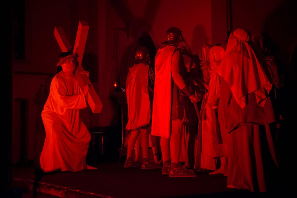 Jesus, played by Stephen Taylor, carries his cross during a March 9 Living Stations of the Cross at St. Mary Church in Corning. The performance was presented by youths from Blessed Trinity/St. Patrick parishes in Tioga County.