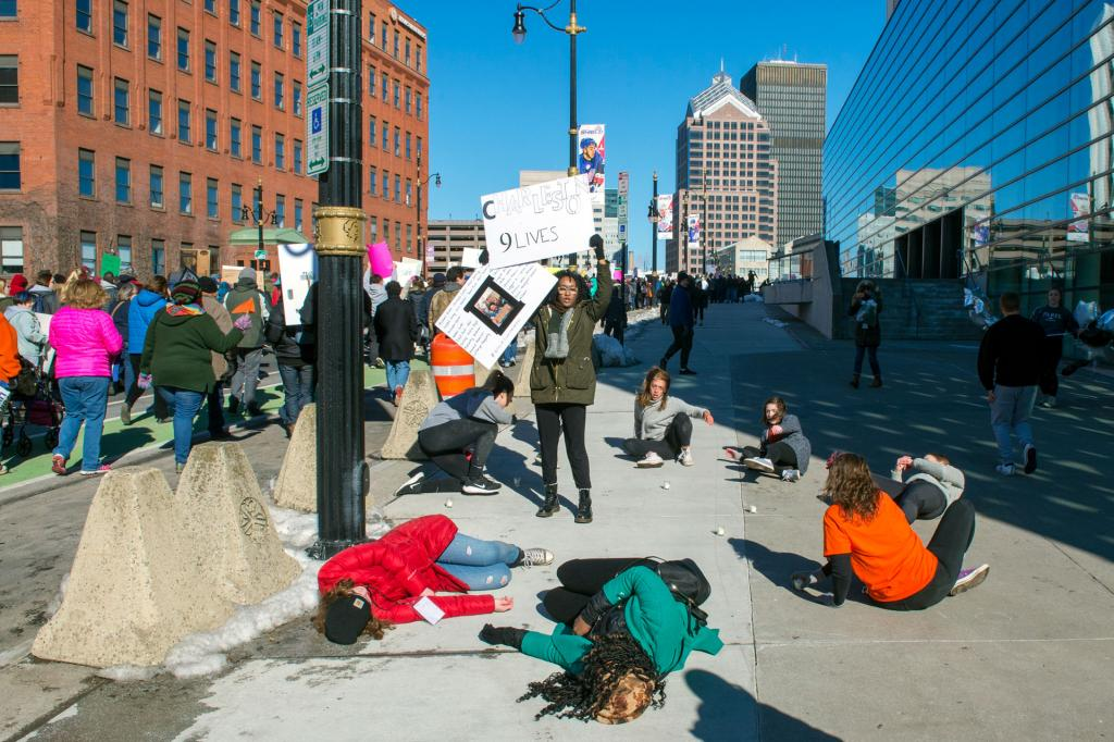Student demonstrators play dead on Broad Street to call attention to those who havelost their lives to gun violence.