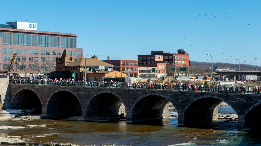 Protesters cross the Court Street Bridge.