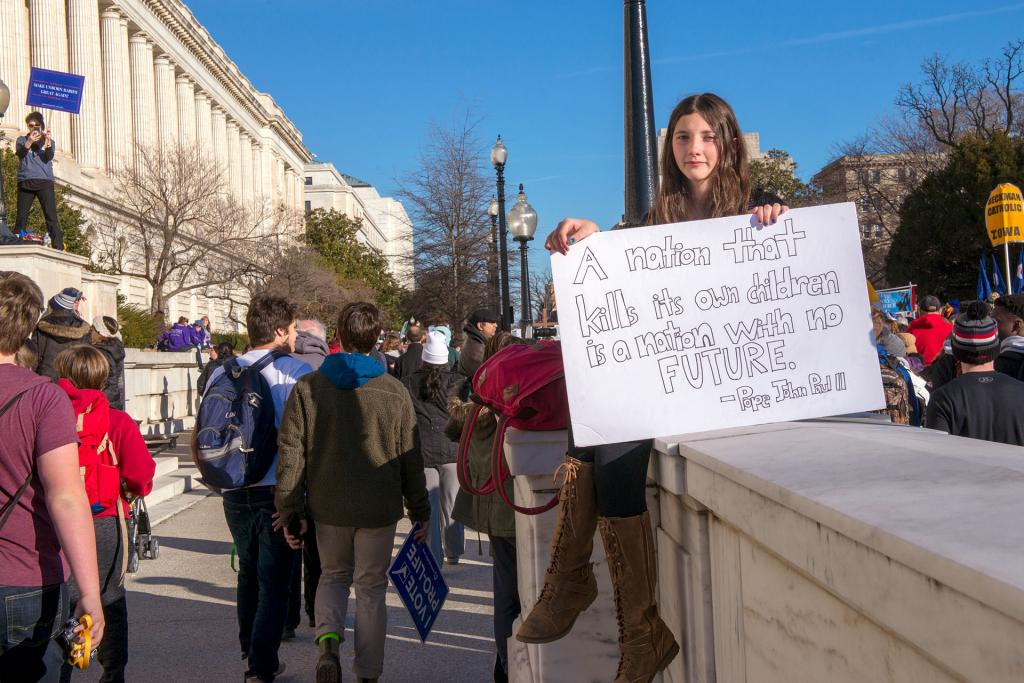 A pro-life marcher displays a sign near the U.S. Capitol building.