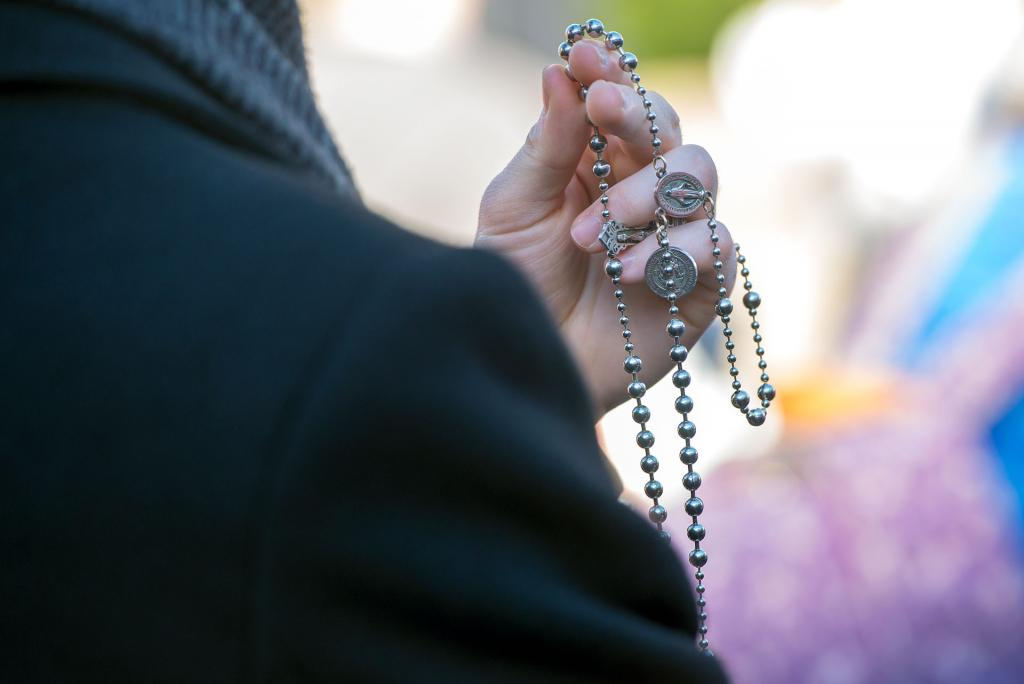 Rochester seminarian Benjamin Knopf prays the rosary during the march.