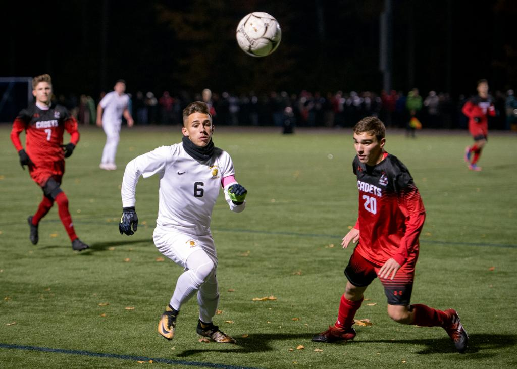 McQuaid Jesuit's Justin LaFountain (left) races Hilton's Aaron Masters (right) for the ball in the first half of the Section 5 Class AA soccer finals Oct. 31 at Spencerport High School.