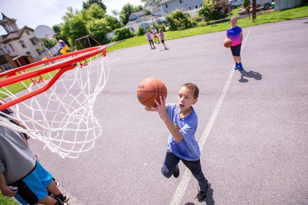 Malakai Swartz shoots a basket during the St. Michael School field day in Penn Yan June 17. (Courier photo by Jeff Witherow)