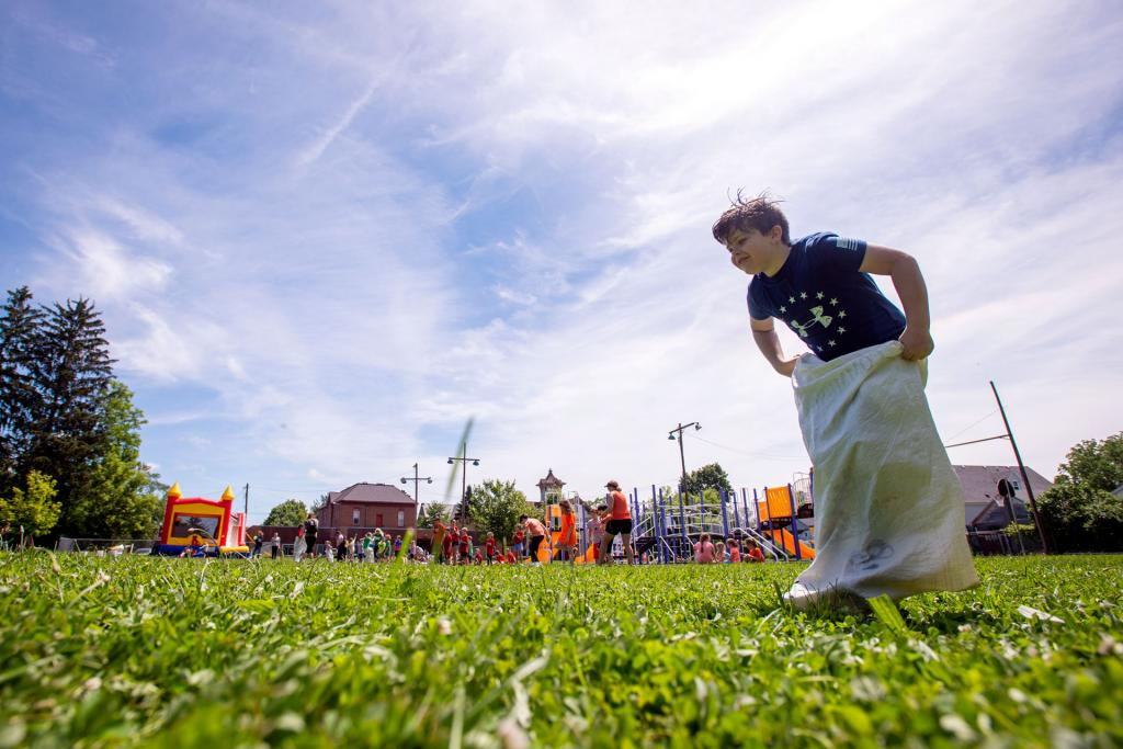 Jack Saner competes in a field day sack race at St. Michael School in Penn Yan June 17. (Courier photo by Jeff Witherow)