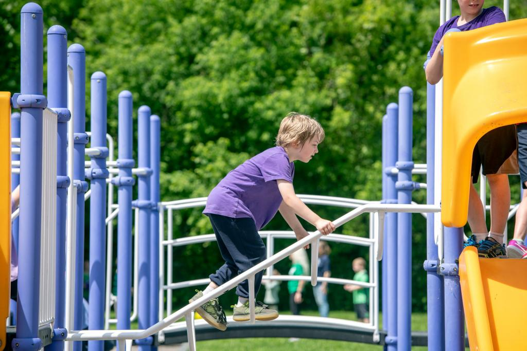 Levi Groom climbs the playground at Penn Yan's St. Michael School June 17. (Courier photo by Jeff Witherow)