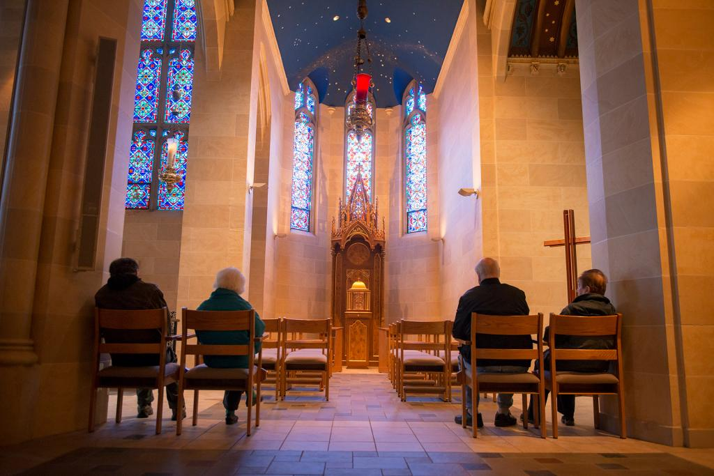 Catholics wait in line for confession in the eucharistic chapel at Rochester's Sacred Heart Cathedral.