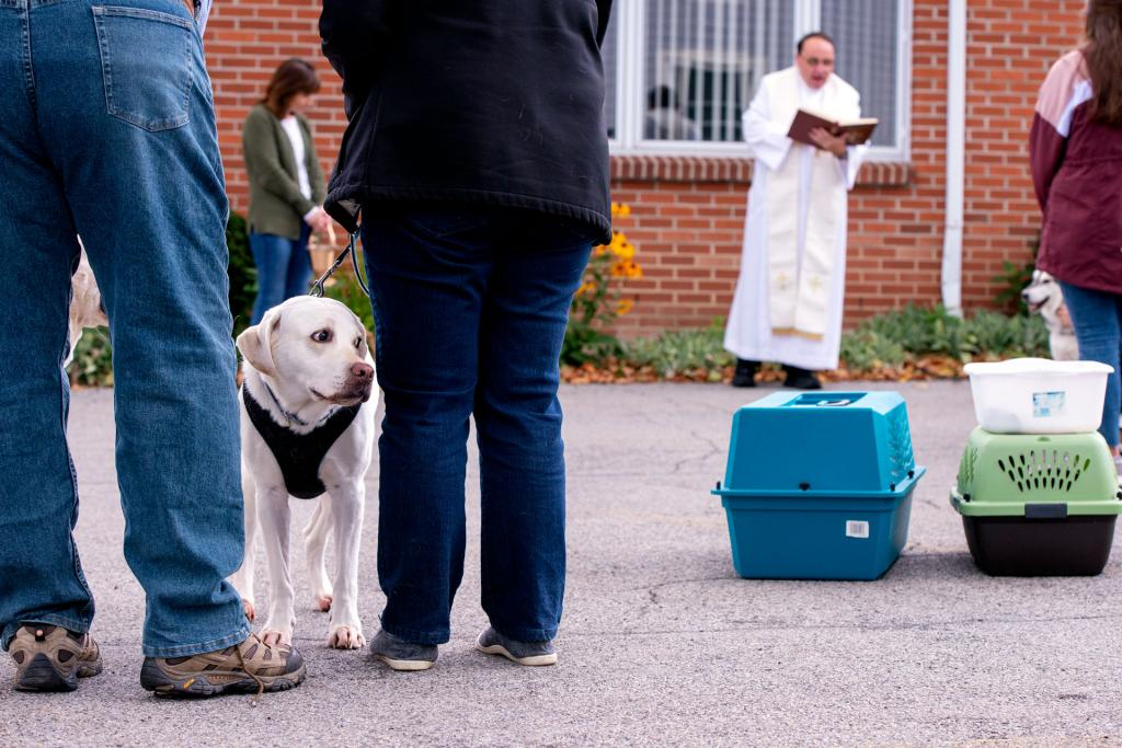 James and Elaine Bennett wait for their dog, Scout, to be blessed by Father Tunnicliff.
