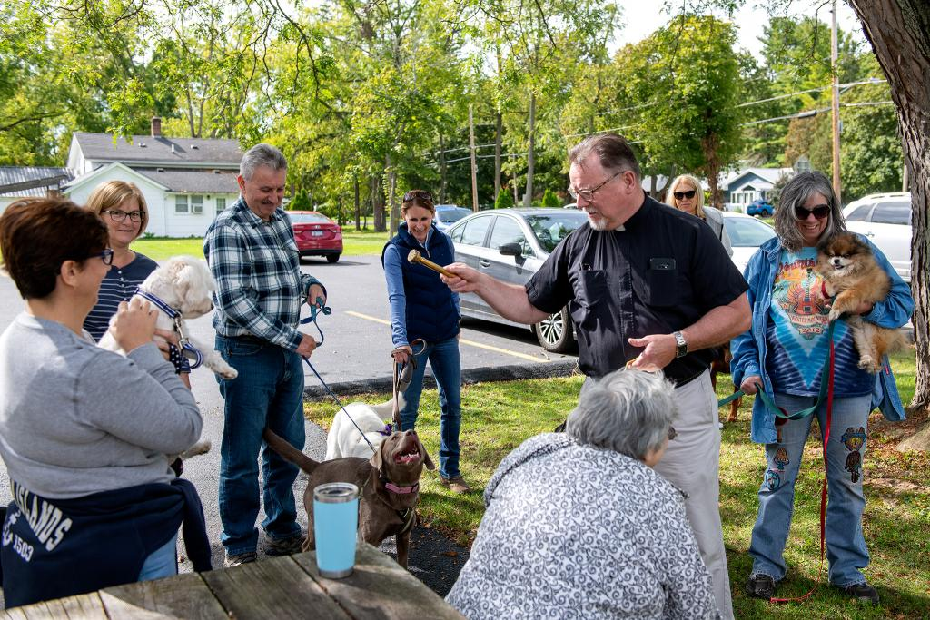 Father Hayes blesses animals with holy water at St. Mary of the Assumption Church.