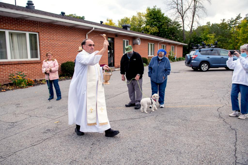 Father Jeffrey Tunnicliff blesses the animals with holy water.