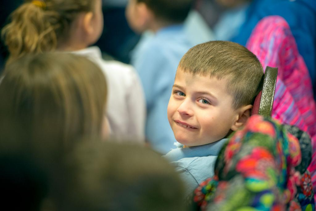 St. Pius Tenth School kindergartner Luciano Fusilli sits after receiving ashes. (Courier photo by Jeff Witherow)