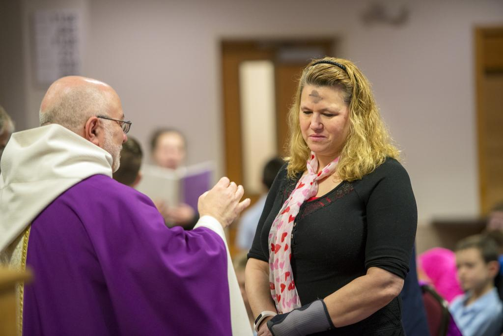 A parishioner receives ashes. (Courier photo by Jeff Witherow)