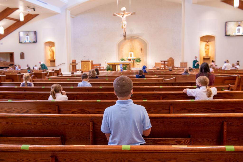 St. Pius Tenth School students participate in their first Mass of the school year at St. Pius Tenth Church in Chili Sept. 18.