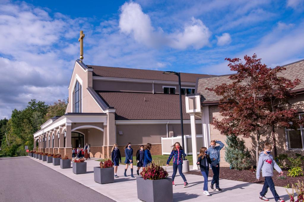 Students return to school in single file after Mass.