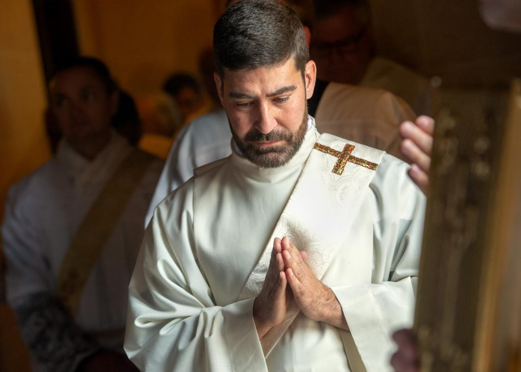 Then-Deacon Jeff Chichester prepares to process into Sacred Heart Cathedral at the start of the priestly ordination Mass June 2.