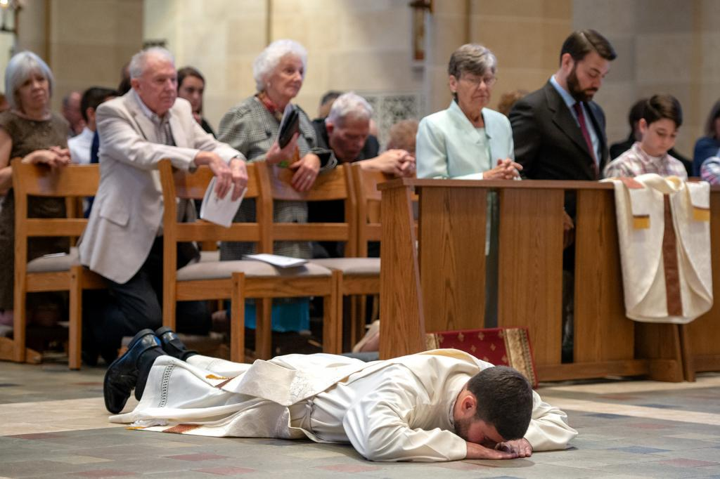 Father Jeffrey Chichester prostrates in front of the altar.