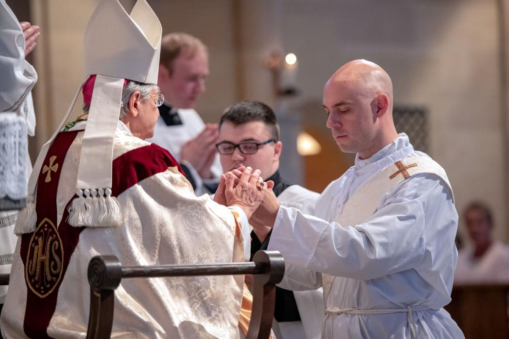 Deacon Matthew Walter promises his respect and obedience to Bishop Salvatore R. Matano and his successors.