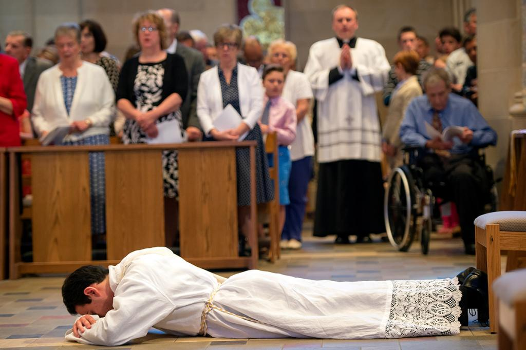 Father Anthony Amato prostrates before the altar during Mass.