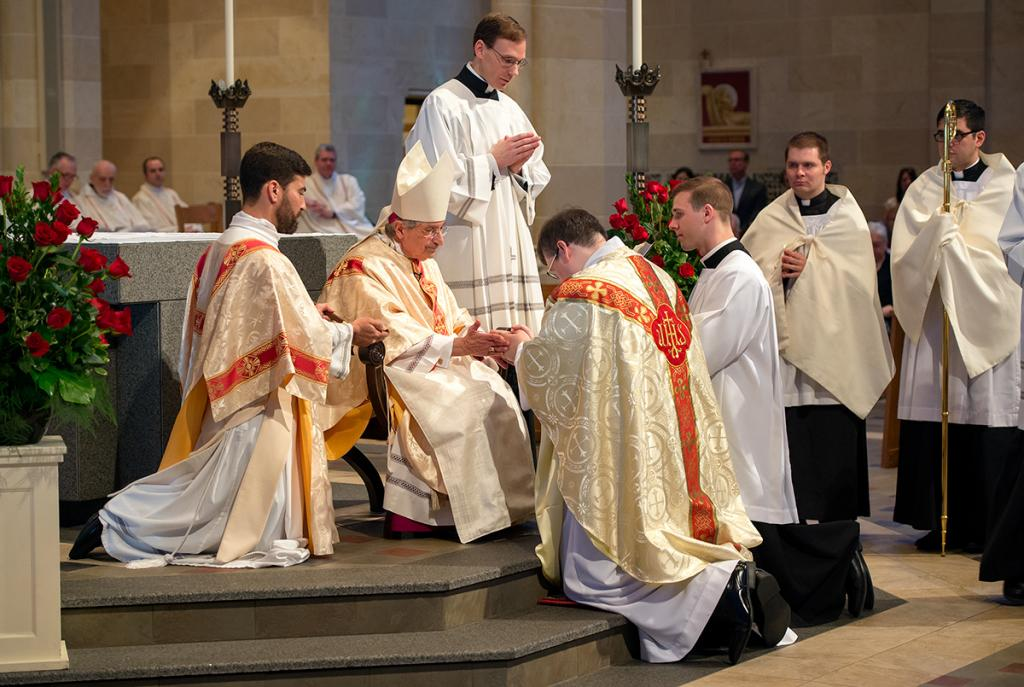 Bishop Salvatore R. Matano anoints Father Merritt's hands.