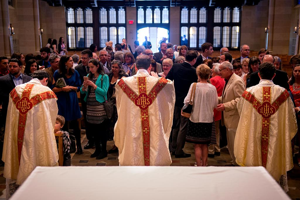 Congregants line up to receive blessings from the newly ordained priests.