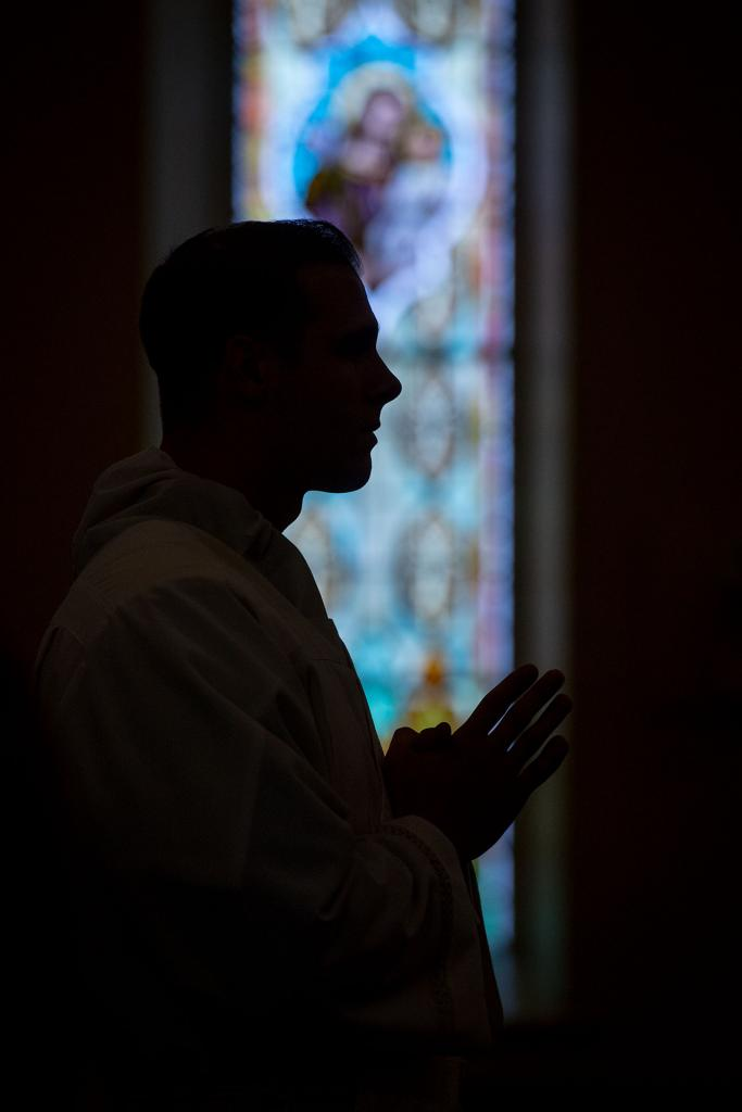 Father Joseph Martuscello stands in the front of St. Mary Church at the start of the ordination Mass.