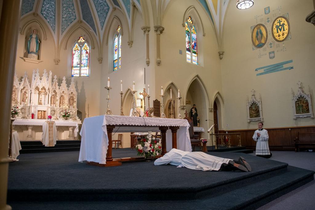 Father Martuscello prostrates before the altar.