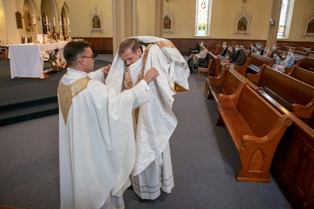 Father Martuscello is vested by Father Matthew Jones.