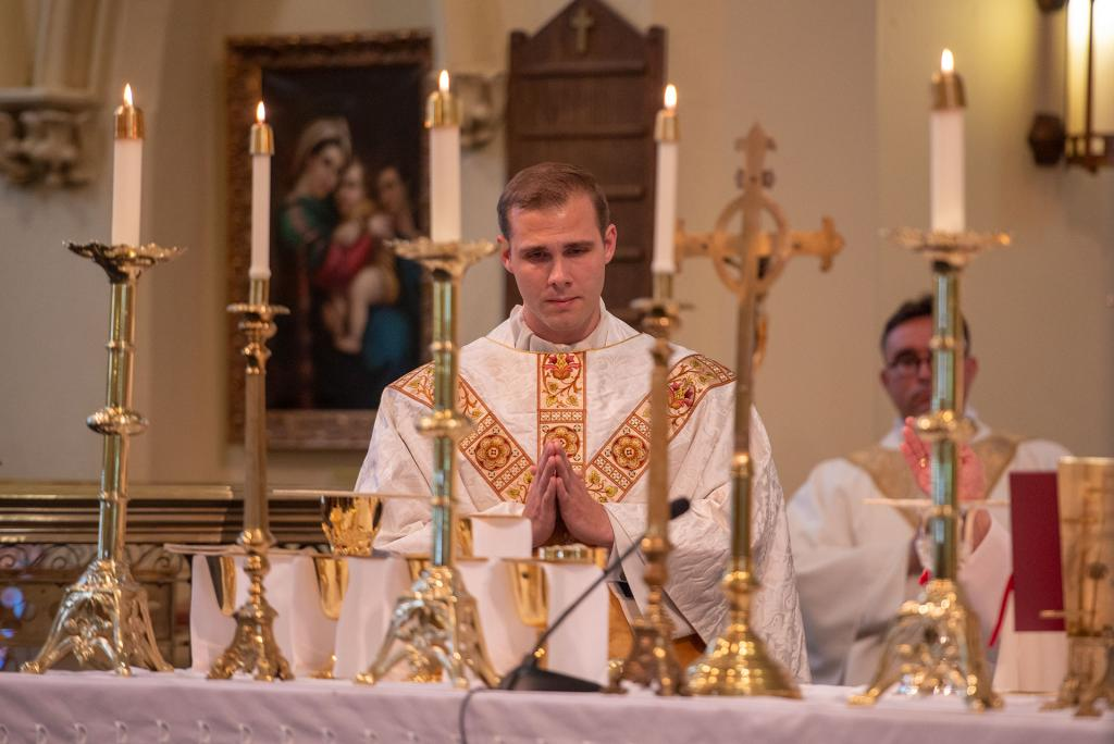 Father Martuscello stands near the altar during the Liturgy of the Eucharist.